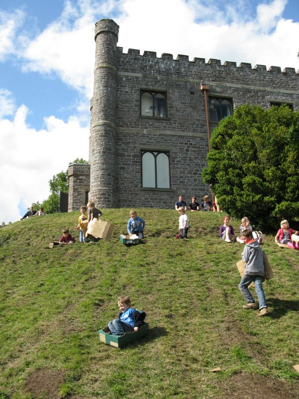 Kids sliding down the castle hill in cardboard boxes at Abergavenny - loved it