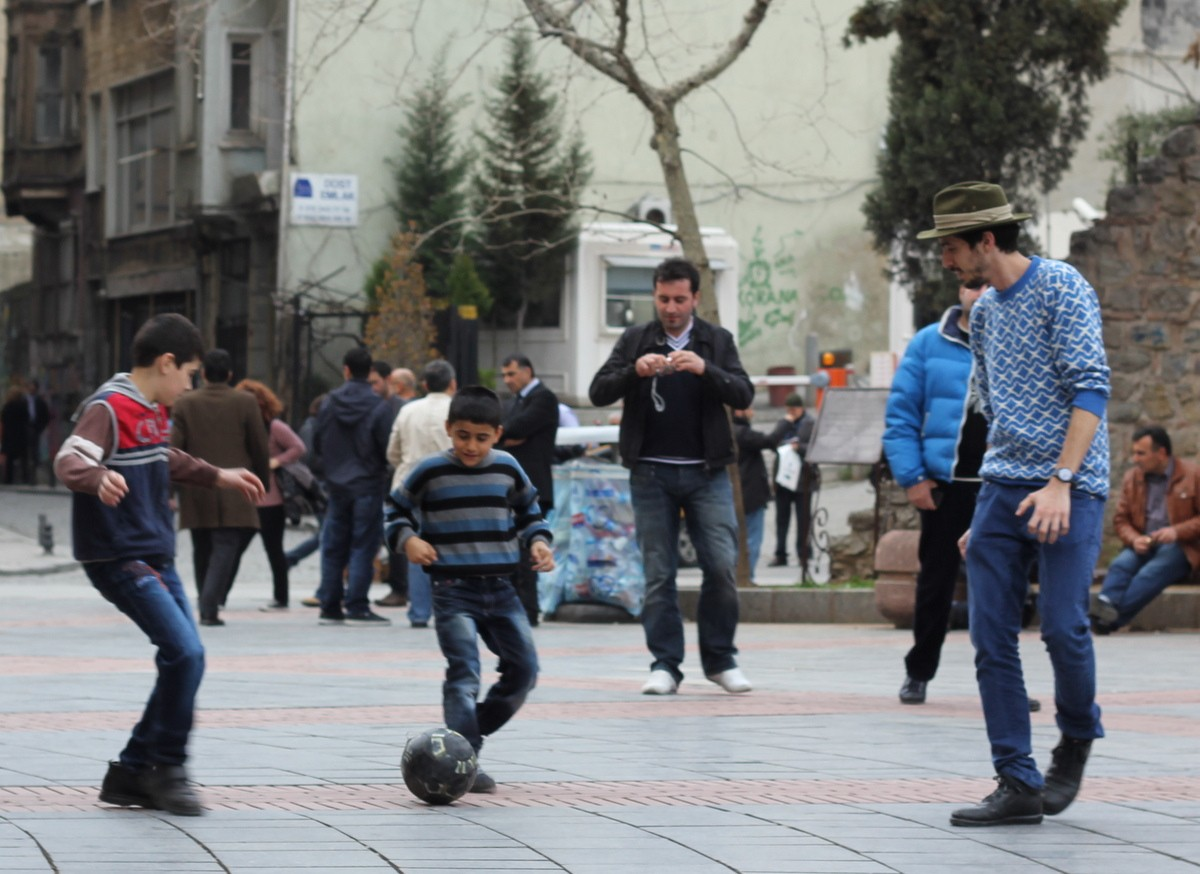 Playing football by Galata tower