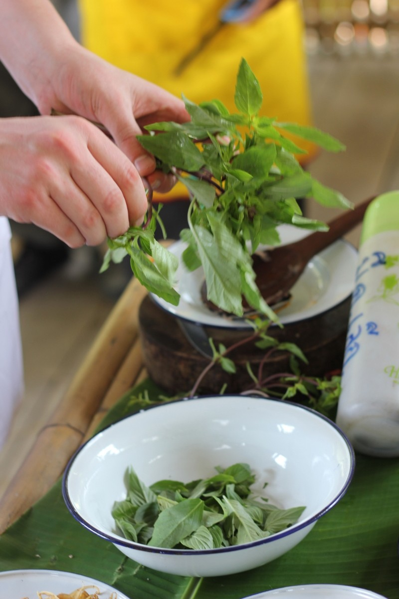 Separate the basil leaves from the stems