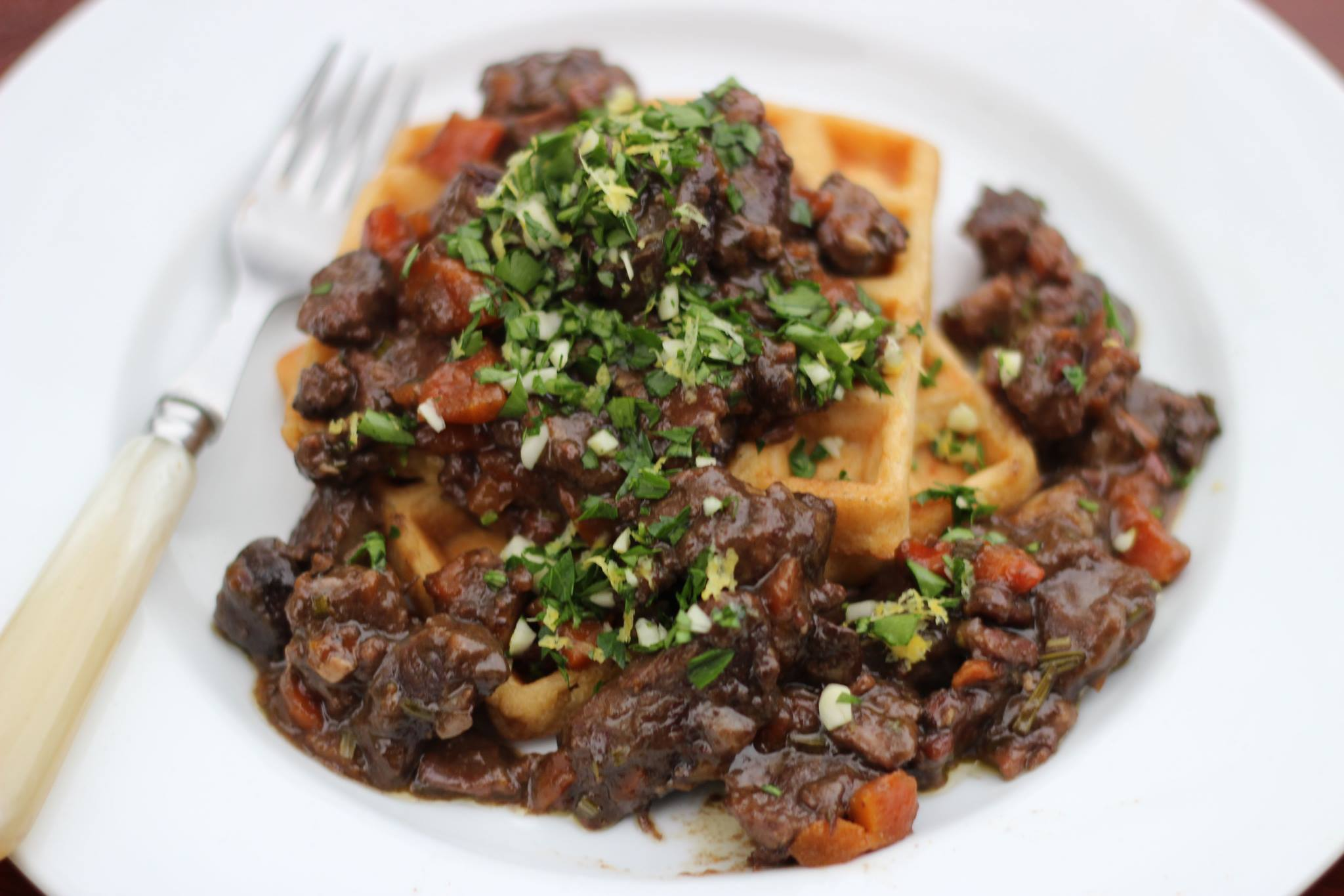 Raised Waffles with Beef and Mushroom Ragu & Gremolata