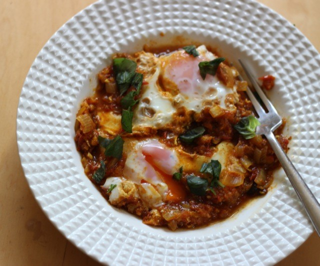Eggs poached in homemade curry - perfect for a cold